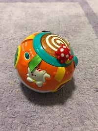 orange, teal, and yellow plastic ball toy Fort Stewart, 31315