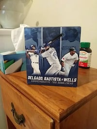 Triple bobblehead with Delgado, Bautista and Wells