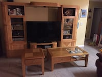Black flat screen TV and brown wooden TV hutch