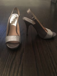 pair of gray leather open toe ankle strap heels
