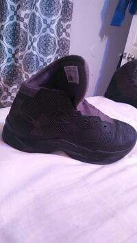unpaired black and purple Under Armour basketball shoes Harrisburg