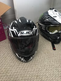 Two black-and-white hjc full-face helmets Moose Jaw, S6H 0Y5