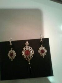 silver-color pendant and earrings