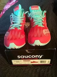 pair of red-and-blue Saucony racing shoes 116 mi