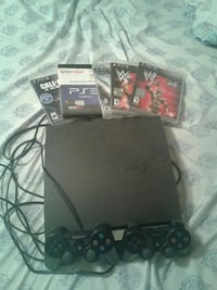 black Sony PS3 slim console with controllers and g Lexington, 29073