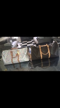 two white and brown Louis Vuitton leather duffel bags New York, 10007