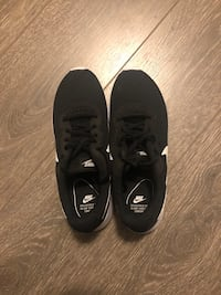 Pair of black-and-white nike running shoes Edmonton, T6W 2R7