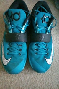 pair of blue Nike KD 7 basketball shoes size 12.5 HALETHORPE