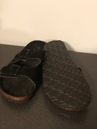 Pair of black leather slip on shoes ( size 8 new )