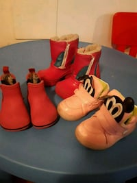 two pairs of red and white boots Montréal, H1A 3W8