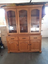 brown wooden glass display cabinet Airdrie, T4A 2A7