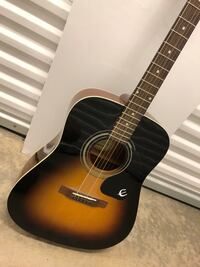 brown and black acoustic guitar Tigard, 97223