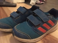 par of blue-red-and-white Adidas running shoes kids size 11