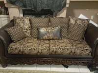 brown and black floral padded loveseat