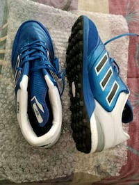 pair of blue-and-white Adidas cleats Manassas