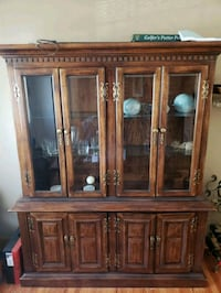brown wooden framed glass display cabinet Centereach, 11720