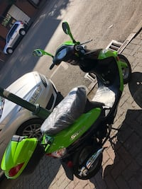 green and black motor scooter Chattanooga, 37402