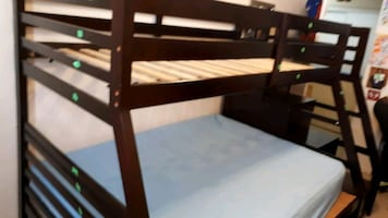 reece  twin over full bunk bed with trundle and storage at the side.