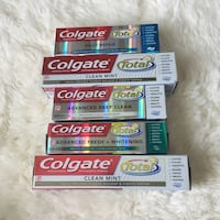 three Colgate toothpaste boxes and two toothpaste boxes Vallejo, 94591