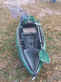 green and black kayak with paddle Melbourne, 32904