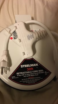 White steelman 30 ft retractable cord reel 28 km