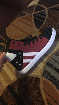 Unpaired red and black high-top sneaker Edmonton, T6C 2L3