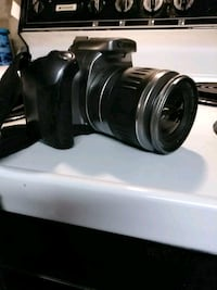black  cannon zoom lens EOS rebel 72 camera Perry