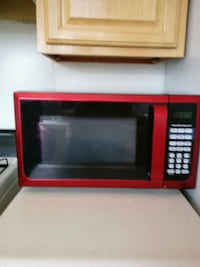 red and black microwave oven 135 mi