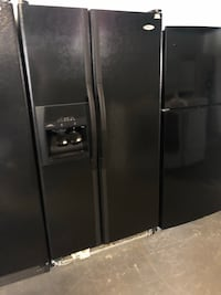 Black side by side refrigerator works perfect  Orlando, 32807