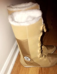Pair of brown Timberland leather snow boots