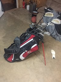 Black and red golf bag with golf clubs Lockport
