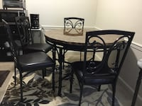 round brown wooden table with four chairs dining set Martinsburg, 25404