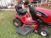 red and black Craftsman riding mower