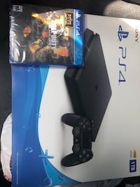 Black sony ps4 slim with controller College Park, 30337