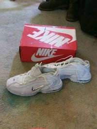 pair of white Nike basketball shoes St. Louis, 63125