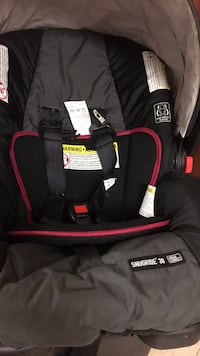 baby's black and red car seat carrier 30 km