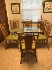 Bamboo Glass Top Dining Table. 45 inch and comes with 6 chairs. Excellent condition! Noblesville