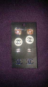 four pairs of silver-colored Chanel earrings Winnipeg, R3C 1Z1