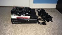 Xbox 360 E with two controllers. two games ,hdmi cable, and power cord