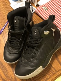 Pair of black air jordan basketball shoes Saint Louis, 63125