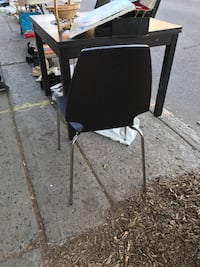 Stainless steel frame black chair from IKEA