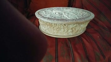 Incolay stone jewelry box with carved bird of para