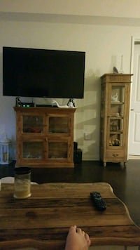 flat screen TV and brown wooden TV hutch 2281 mi