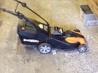 Black and yellow battery power lawn mower  Montréal, H3W 2A2