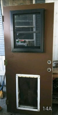 35 1/2 x80 steel door w/ window and doggy door Lakeland, 33801