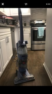 black and gray upright vacuum cleaner 22 km