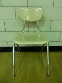 white plastic armless chair New York