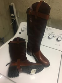 pair of women's brown leather knee-high boots Middletown, 10940