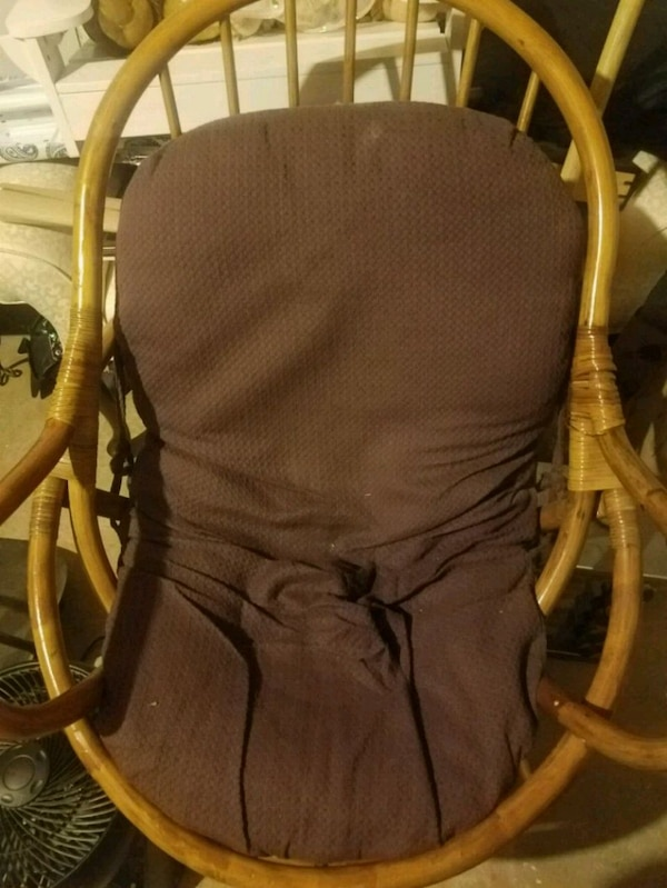 brown wooden frame black padded rocking chair