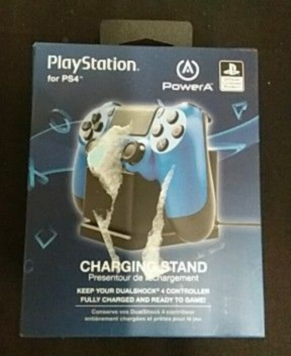 blue Sony Playstation charging stand box